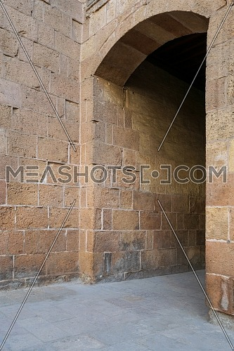 Stone brick wall with aged vaulted passage, Old Cairo, Egypt