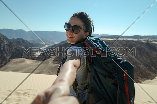 Follow me shot for a female tourist in Ain Hodouda in sinai by day