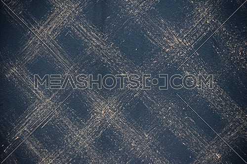 Metal surface texture background painted with black with brushed traces forming checkered pattern