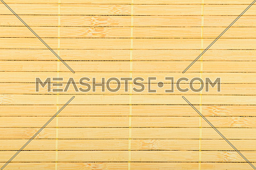 Bamboo wooden light yellow wicker braided mat with thread background