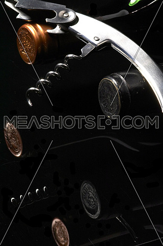 wine bottles with corkscrew on black background