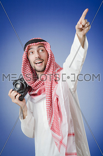 Arab photographer in studio shooting