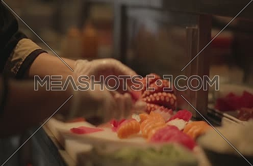 sushi chef preparing a fresh meal