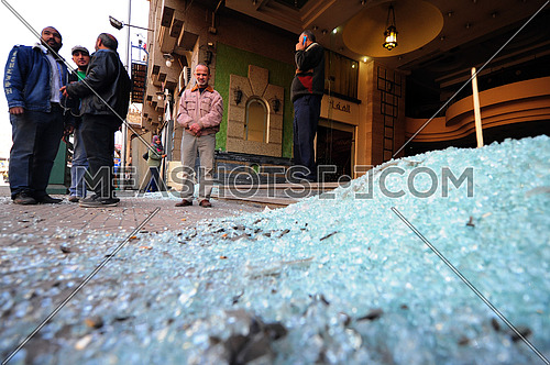 broken glass after A car bomb explosion at the police headquarters in Cairo on 24 January 2014