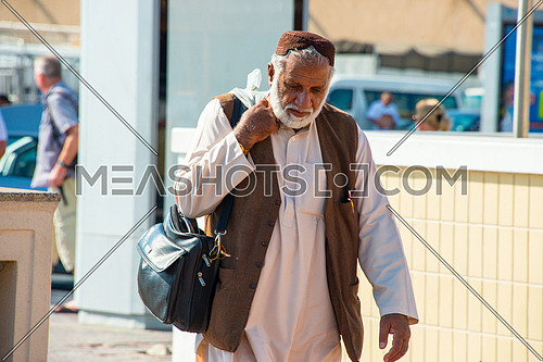 An old man walking down the street