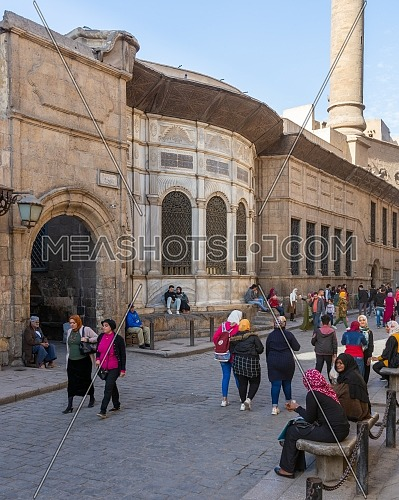 Moez Street with facade of Ottoman era historic Soliman Agha El Silahdar complex building, Old Cairo, Egypt