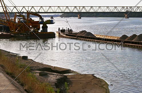 Boat ride with the view of a boats deck and river Tanker ship approaching shore of Danube river in Belgrade