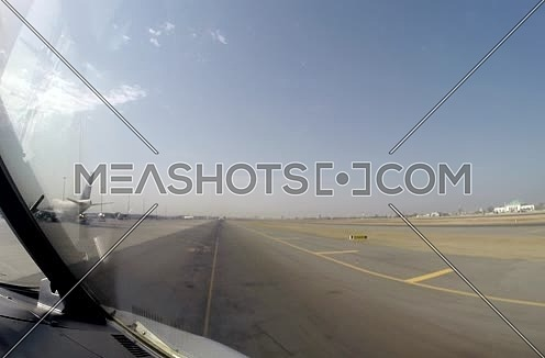 inside cockpit shot for plane moving on runway at  Airport at day