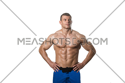 Young Muscular Man Posing In Studio Showing Abs - Isolated On White Background