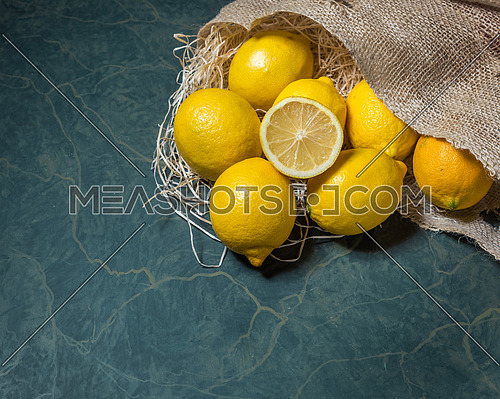 Fresh lemons stacked on hessian sack