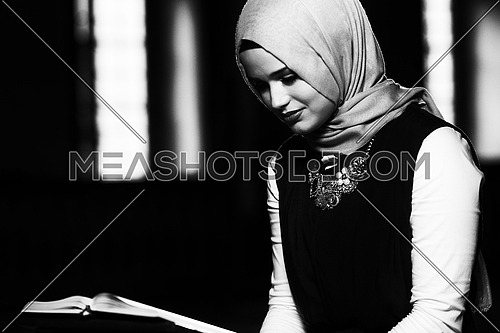 Humble Muslim Woman Is Reading The Koran In The Mosque