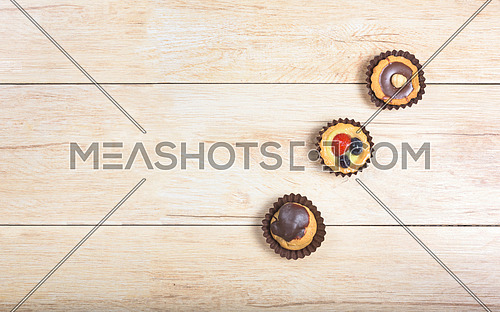 Pictured pastries on light wood background,above view with copy space.