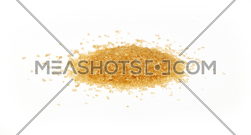 Pinch of brown cane sugar spilled around isolated on white background, close up, low angle view