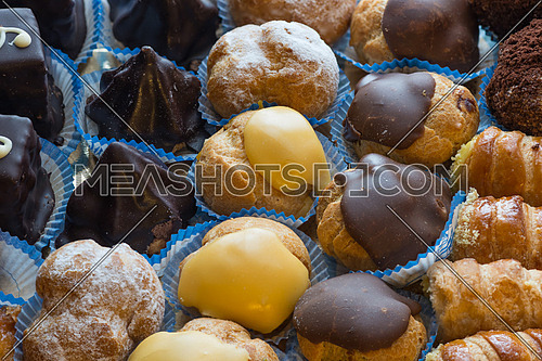 In the pictured colorful pastries with candied,cream and chocolate from above,the real Italian confectionery.