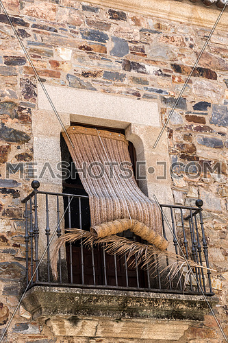 Typical balcony of the old town of Caceres, Spain