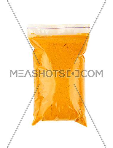 Close up one plastic zip lock bag full of yellow turmeric powder spice isolated on white background