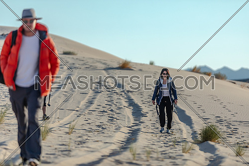 Group of tourists walking on sands while exploring Sinai Trail from Ain Hodouda at day.