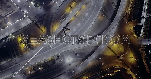 Aerial top left of spirally 6 of October Bridge over Abd Elmonan Reyad Bus Station At Tahrir Area in cairo at night