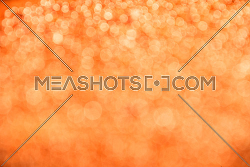 Orange festive glitter tender bright magic light circles abstract blur effect summer and autumn background