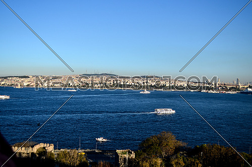 The city of Istanbul appears away behind the sea and also ships appears in the view at day