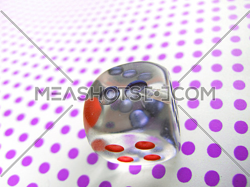 gamblig dice on doted background