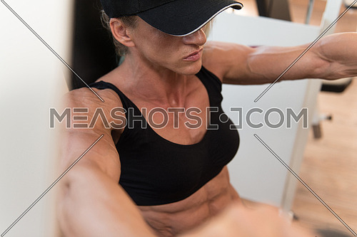 Middle Aged Woman Doing Heavy Weight Exercise For Chest