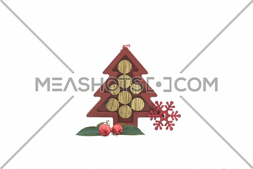 Christmas decorations composition with small brown wooden Christmas tree decorative and snowflakes isolated on white background