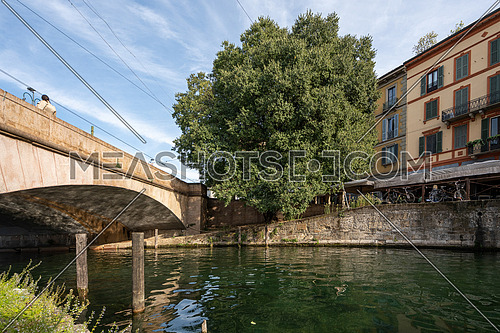 Nice view along the shore of the Naviglio Milanese canal ,sunny day.Milan Lombardy Italy
