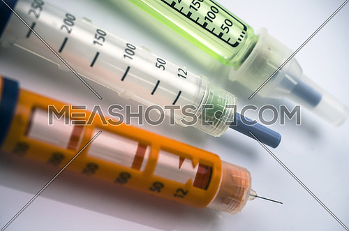 Several Injectors of insulin, conceptual image, composition horizontal