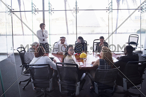 multi ethnic  business people group on meeting at modern  office