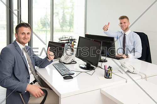 Happy Smiling Cheerful Business Men With Thumbs Up Gesture