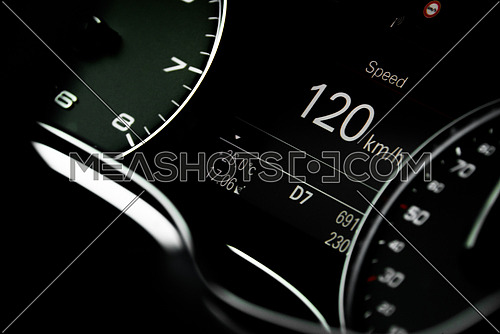 A car dashboard showing car moving at 120 KM/H
