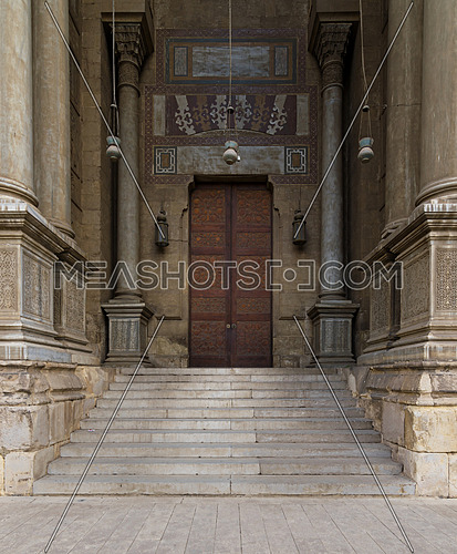Stairs and wooden door leading to Al Rifai Mosque, Cairo, Egypt