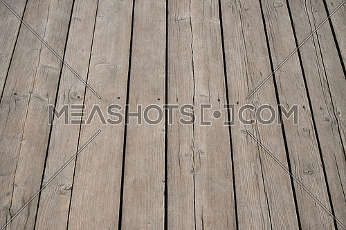 Old vintage rustic aged antique light wooden sepia surface with gaps in perspective