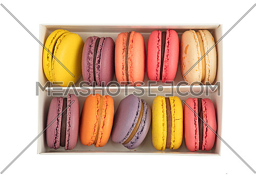 Box of fresh colorful French macaroon pastry cookies (macarons, macaroni) isolated on white background, close up, elevated top view, directly above