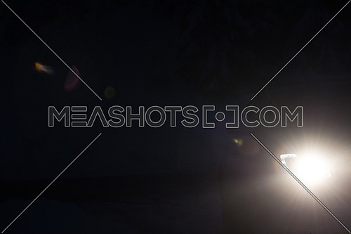 driving car in night,  modern front lights lens flare in black background
