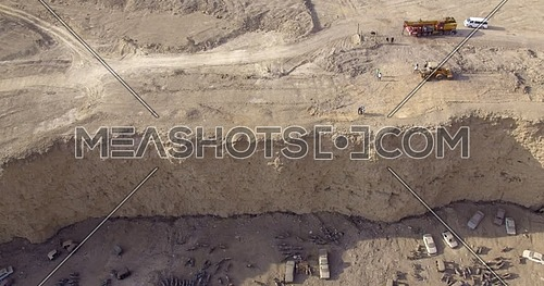 Reveal Shot for Wrecking yard from over Al Mukattam Mountain in cairo at Day