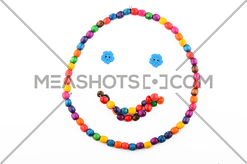 Smile of colorful handmade wooden round beads necklace and bracelet isolated on white