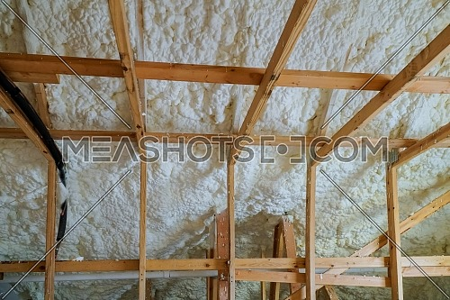Insulation of attic with foam insulation cold barrier and insulation material polyurea Spraying, foam coating