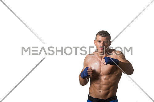 Muscular Boxer MMA Fighter Practice His Skills - Isolated On White Background