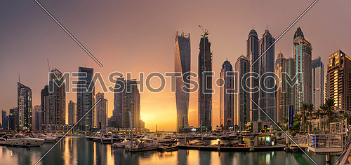 Dubai Marina skyline with glowing warm sunset