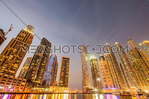 Dubai marina skyscrapers during night hours