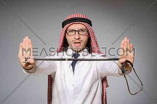Funny arab doctor with stethoscope