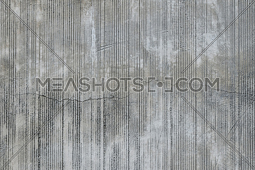 Grey concrete wall with parallel traces from rubbed finish processing abrasive machining and crack check