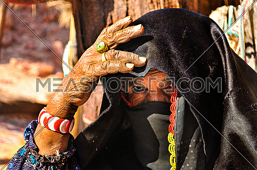 Sinai Bedouin woman with her traditional clothes and age marking on her skin