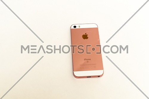 The back of a bent Iphone 5 SE, in white and rose gold. December 2018. Cairo - Egypt