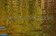 Colorful yellow and golden ripples and waves running on water surface create hypnotic zigzag crankle effect, moving flow background, Full HD 1080
