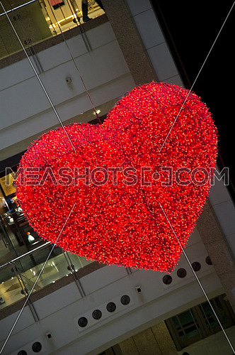heart shaped light hanging on a shopping mall ceiling
