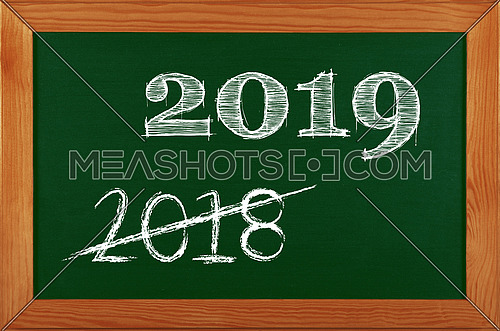 Green school chalkboard blackboard sign in brown wooden frame with 2019 and 2018 strikethrough chalk text