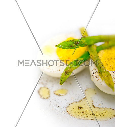 boiled fresh green asparagus and eggs with extra virgin olive oil
